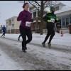 Despite a winter snowstorm, paczki runners stay on track