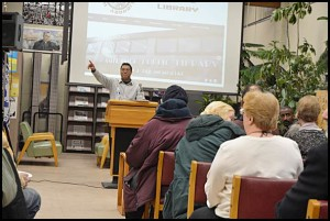Ron Orr of the Hamtramck Community Initiative talks about current projects in the city at last week's Town Hall meeting, held in the public library.