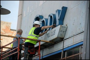 The sign for the former store is taken down.