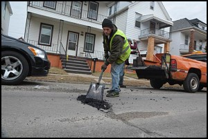 Don't expect anything more than cold patching for city streets. Anything more permanent will have to wait until a city manager is hired.