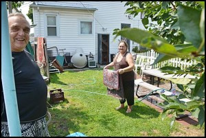 Despite having a major clean-up to do, these residents were still smiling.