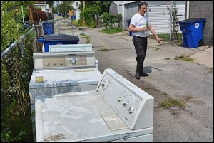 After Monday's flooding, many households were forced to throw out contaminated and ruined appliances and other items. Some residents decided to salvage what they could and scrubbed their possessions clean.