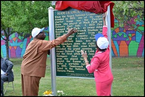 Hamtramck School Board President Titus Walters and Linda Forte of Comerica Bank unveil a historical marker for Hamtramck Stadium, home to the famed Detroit Stars of the Negro League, during a ceremony Thursday afternoon. Comerica Bank donated $5,000 for the marker.