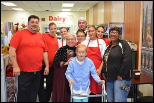 The clan at Bear's Deli poses with Mayor Karen Majewski (center) at the deli's recent grand opening. The eatery is at the former location of the Kowalski Deli on Jos. Campau.