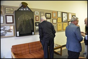 A friend of Nick's looks at the memorabilia collection.