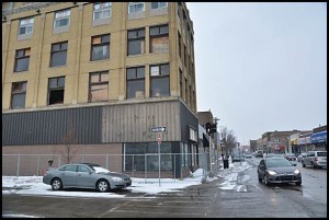 Fencing around the Jos. Campau-Belmont building should be removed soon now that the building's brickwork and mortar have been secured.