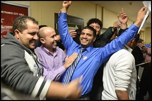 Top vote-getter Saad Almasmari(center) celebrates his victory to city council on election night.