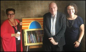 Dickinson West Elementary School teacher Suzana Bosnjakovski, Stuart Tucker and Dr. Mary-Catherine Harrison pose next to the newly installed Little Library that students will be able to access for free. Tucker, a Hamtramck resident, and Harrison helped bring about the library.