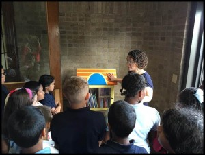 Dickinson West students are introduced to the Little Library by Dr. Mary-Catherine Harrison.