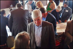 "Gov. Rick Snyder and some of his top administrators visited with local officials and community members on Friday afternoon to talk about a new development initiative for the city called ""Project Rising Tide."" Photo by Walter Wasacz."