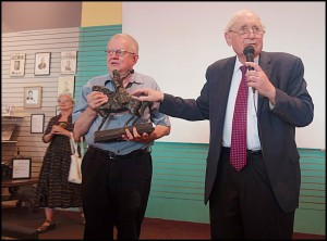 "Former U.S. Senator Carl Levin presents a replica statue of Thaddeus Kosciuszko to Hamtramck Historical Museum Director Greg Kowalski at last week's unveiling of the museum's mural ""Coming to Hamtramck."""