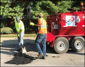 A Domino's pothole repair crew hit the streets this week. No, that's not pizza dough they are using to fill the potholes.