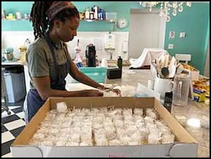 Jamila Kokumo prepares a batch of macrons at Le Detroit Macron Bakery, located on Evaline just west of Jos. Campau. The bakery is celebrating its one-year anniversary this Sunday (Sept. 23).