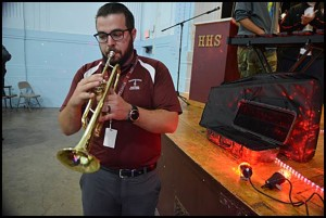 Hamtramck High School music teacher Thomas Course plays a trumpet that was one of several instruments donated to the school.